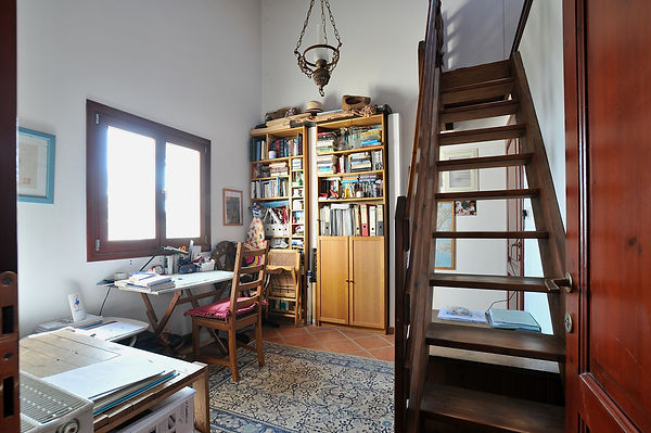 Office with window over, wooden stairs