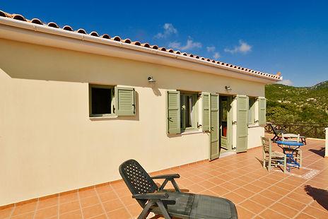 french Windows and balcony of an Alonissos villa.