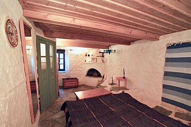 Wooden beamed ceiling bedroom