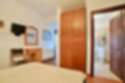 Bedroom with door to en suite shower