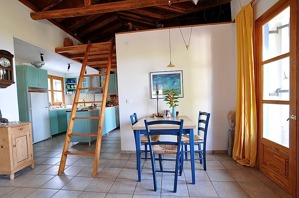 Dining table and three blue chairs