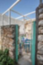 Door opening into a ruin courtyard on Alonissos