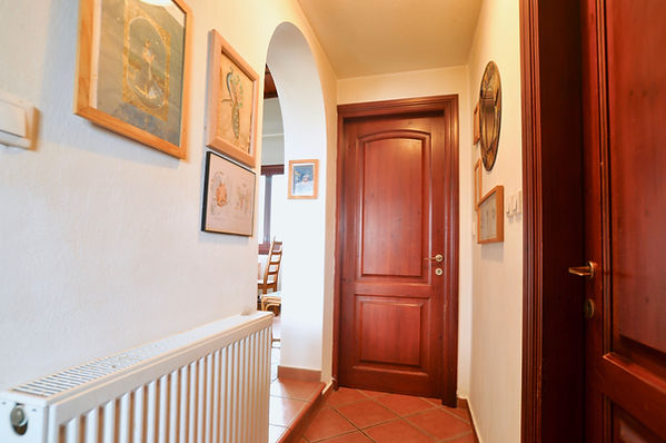 Hallway withtwo wooden doors
