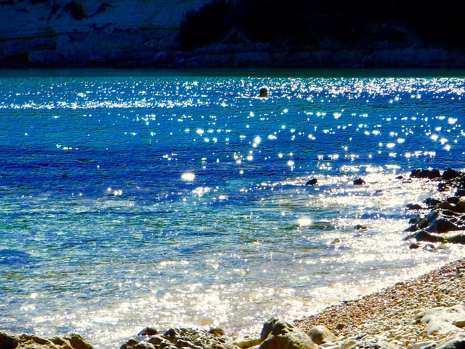 Sparkling sea water of the blue Aegean sea.