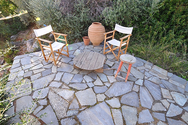 Stone patio with two deck chairs