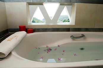 A white bath with small window behind.