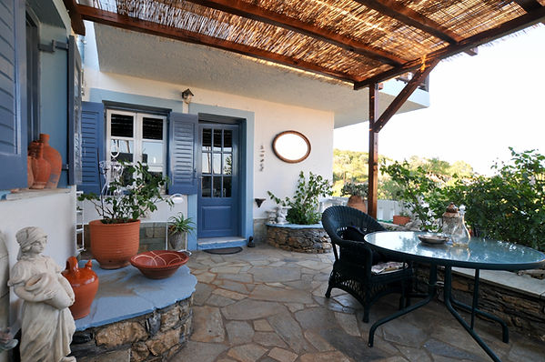 Greek shaded courtyard with door to house