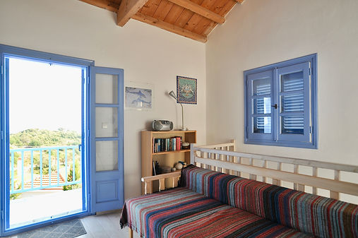 Blue open French windows to blacony in Greece.