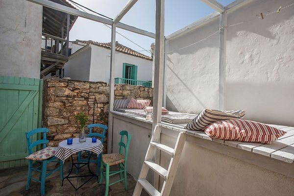 Old courtyard acroos the raod from an Alonissos town house for sale.