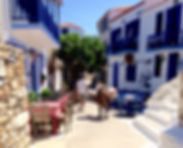 Donkey making deliveries in old village of Alonissos