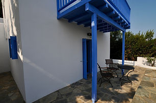 Courtyard under blue wooden balcony.