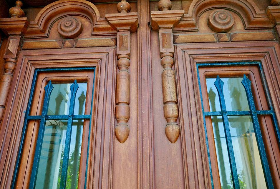 Hardwood decorative door with windows.