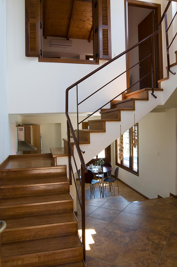 3.villa-Petra-staircase-and-room-entranc