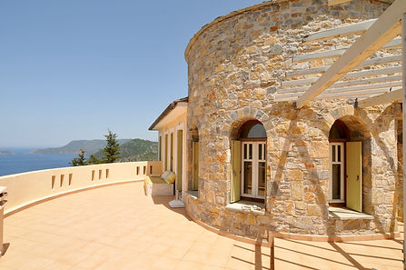 Upper terrace with sea views and stone w