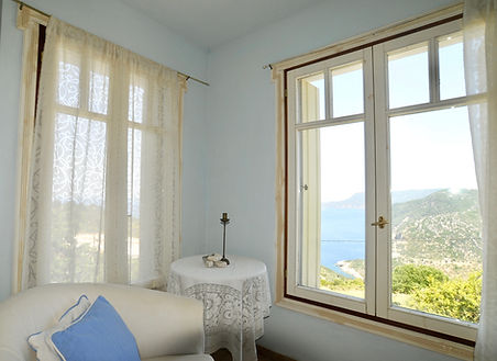 Corner of Bedroom with View out of windo