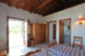 Bedroom with french windows and door to en suite bathroom.