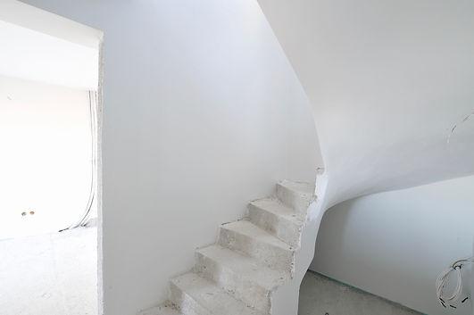 Bottom of stairs.