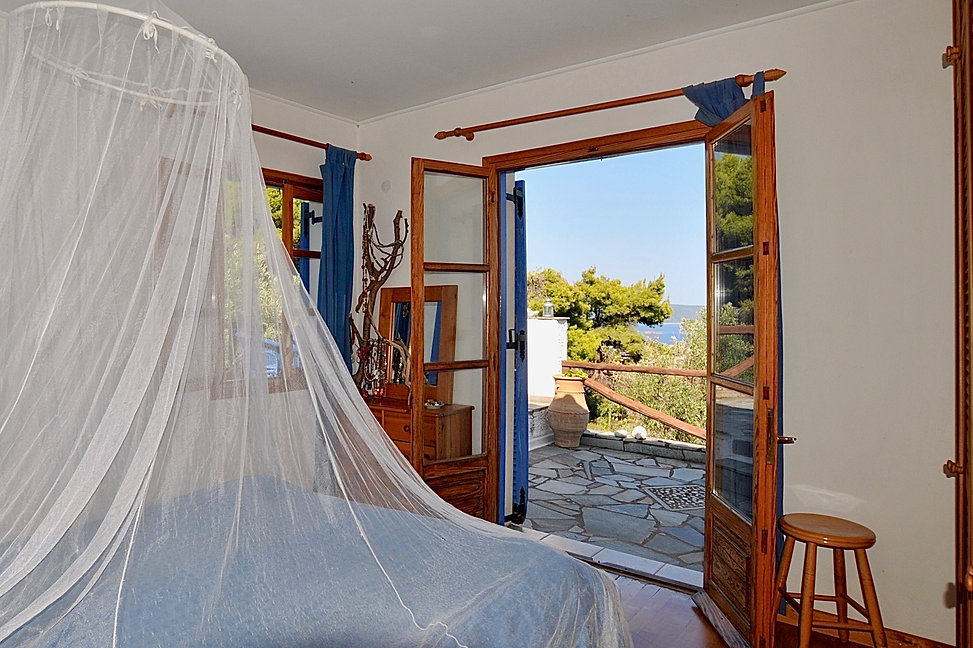 Bed with mosquito net with window to side
