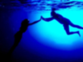 Underwater photo of two people in blue w