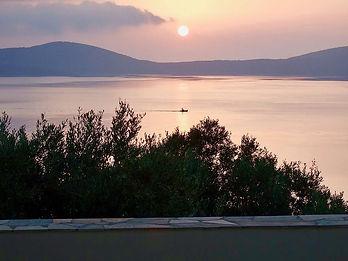 Sunrise behind the island of Peristera.