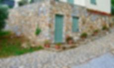Stone driveway and stone wall villa.