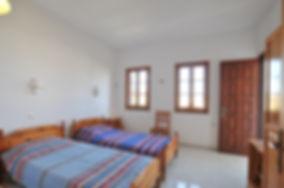Bedroom with two windows and door