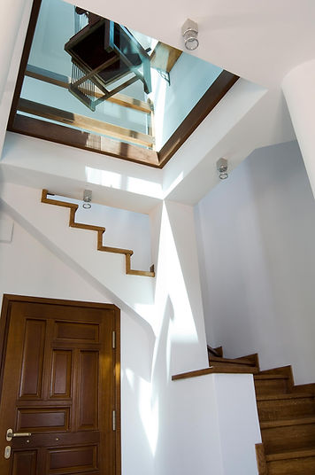 Staircase leading up to glass floor.
