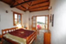 Bedroom with stone floor