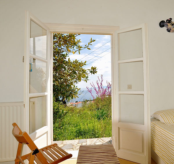 French windows from 2nd bedroom, looking out to the garden.
