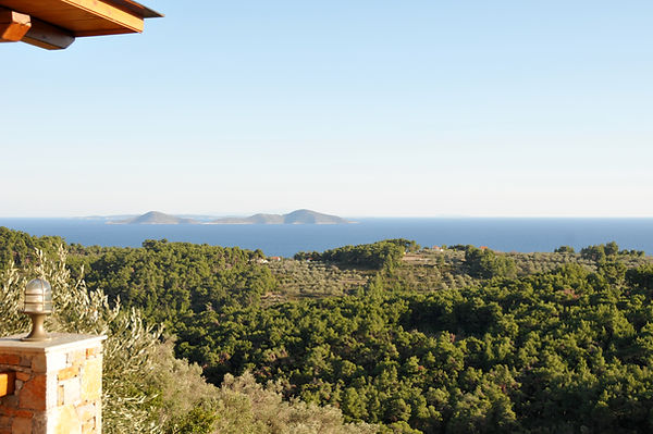 Stunning view from the veranda, looking out to the two brothers across the woodland of Alonissos.
