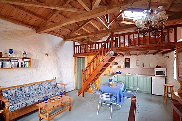Open plan living room with kitchen and mezzanine floor above