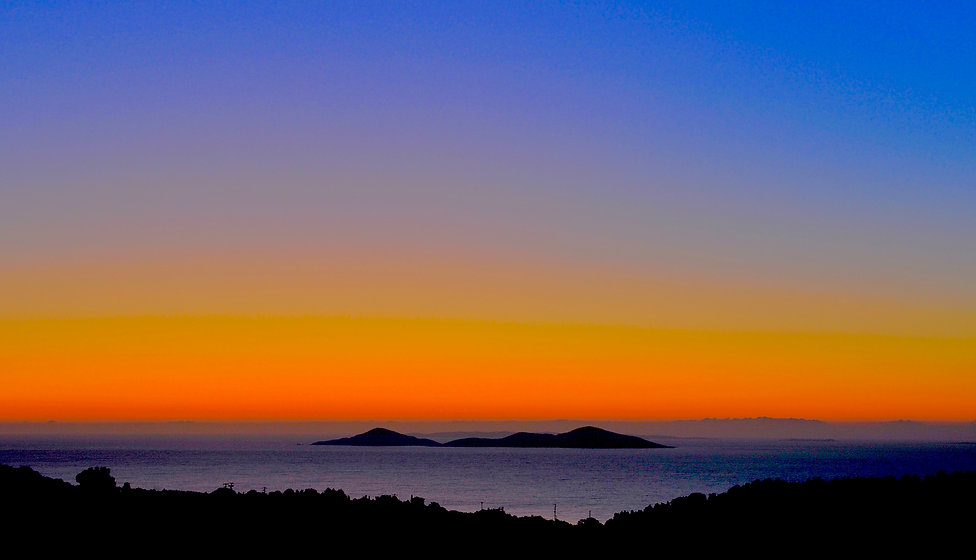 A beautiful sunrise showing orange sky and the islands around Alonissos, Greece.