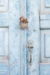 Old blue Greek door with lock
