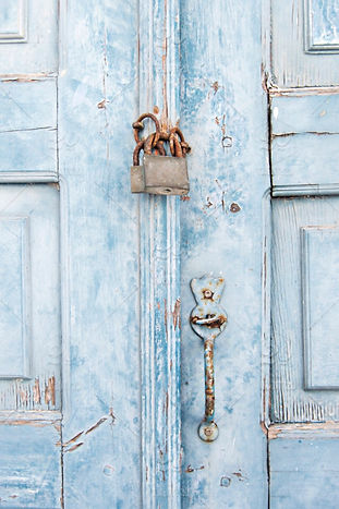 Old Greek locked front door, painted in shabby chic blue.