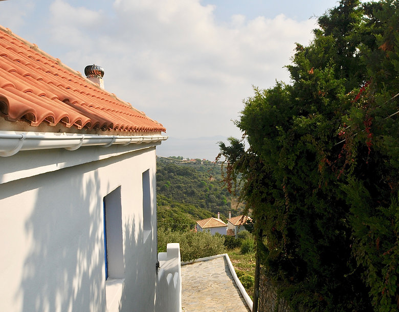 Side of small house and sea view