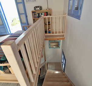 Stairwell to lower bedroom.