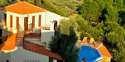 Ariel view of Greek villa with infinity swimming pool.