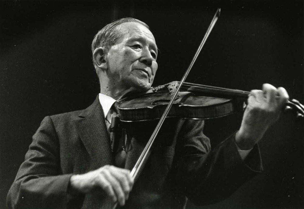 Shinichi Suzuki playing violin