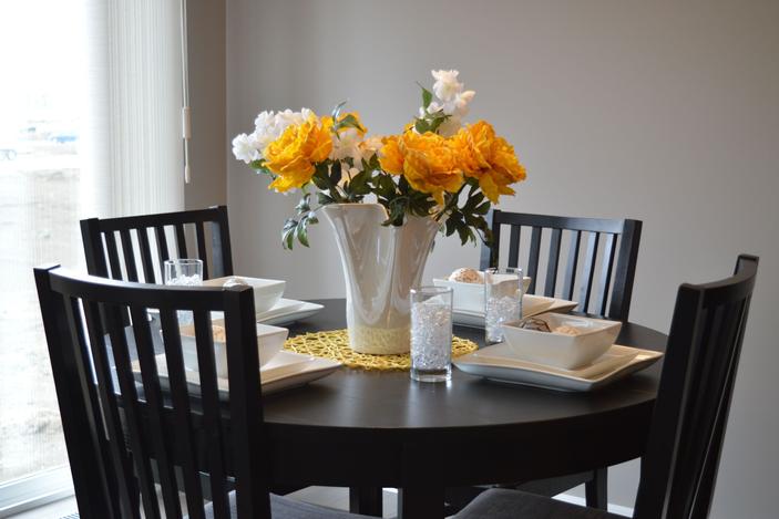 Fresh vibrant color offsets the dark wood furniture.