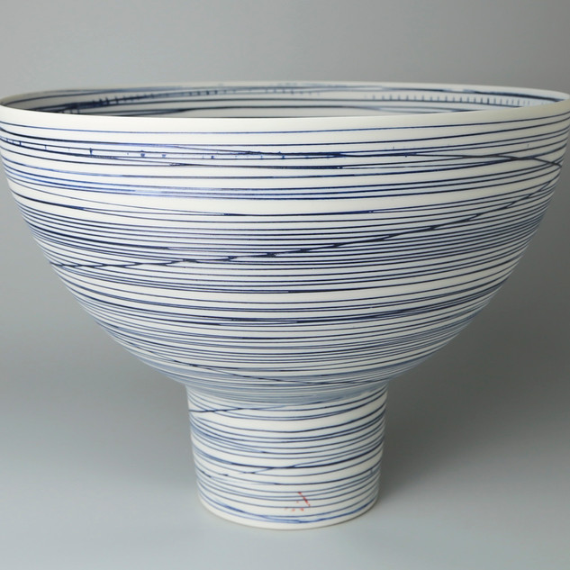Tall footed bowl. Blue lines