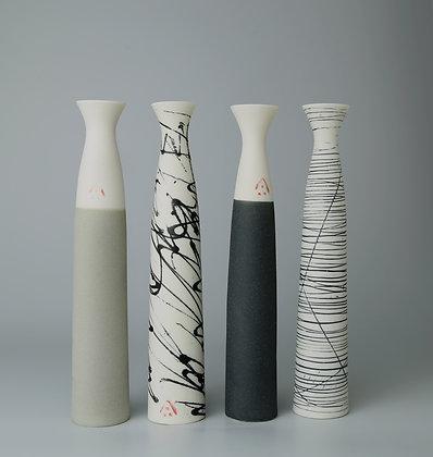 Set of four fluted stem vases. Olive and blacks
