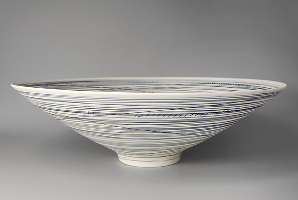Large, footed bowl. Blue lines