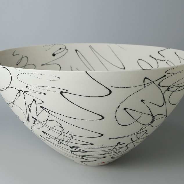Rounded bowl. Black scribbles