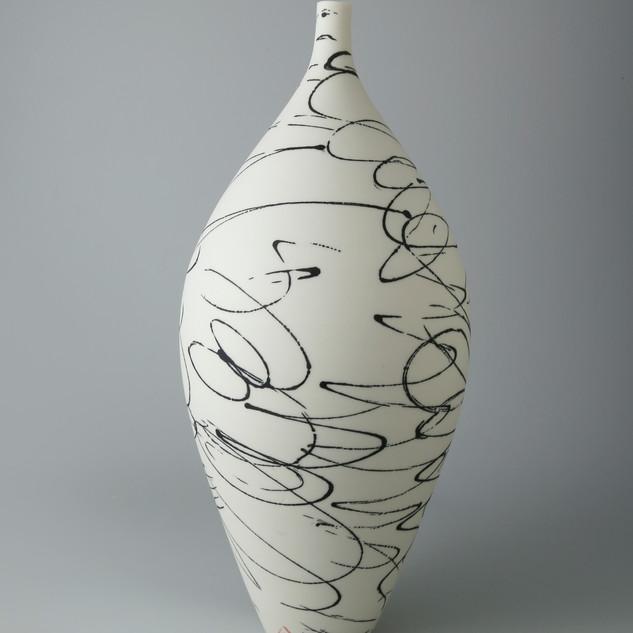 Bottle vase. Black scribble