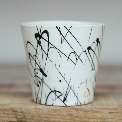 Small cup.Black scribble