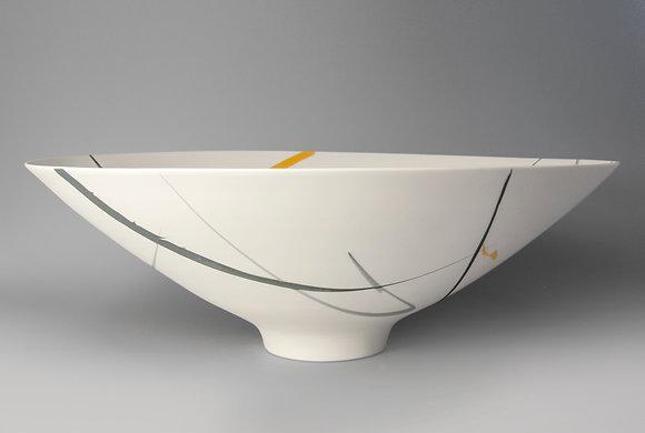 Large, footed bowl. Yellow & grey splash