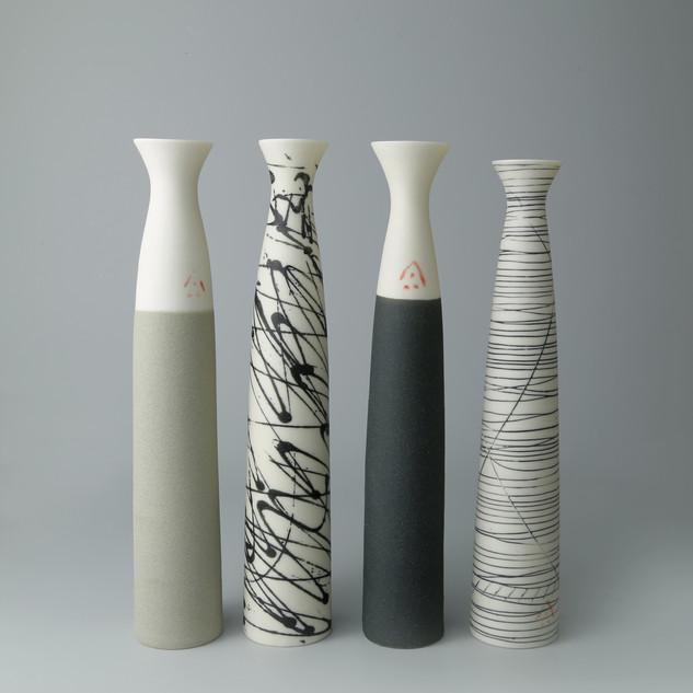 Set of four fluted stem vases.
