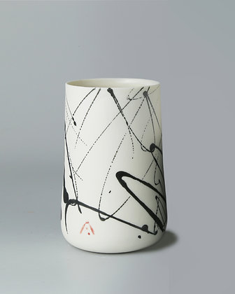 Tall cup. Black scribble.