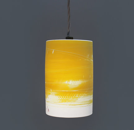 Small light. Cylinder shape. Yellow