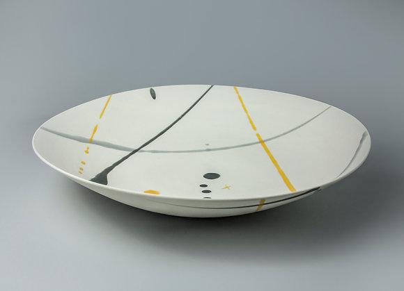 Wide, shallow bowl. Yellow & grey splash